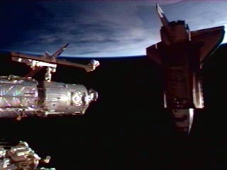 Screenshot of NASA TV showing Endeavour docking with ISS